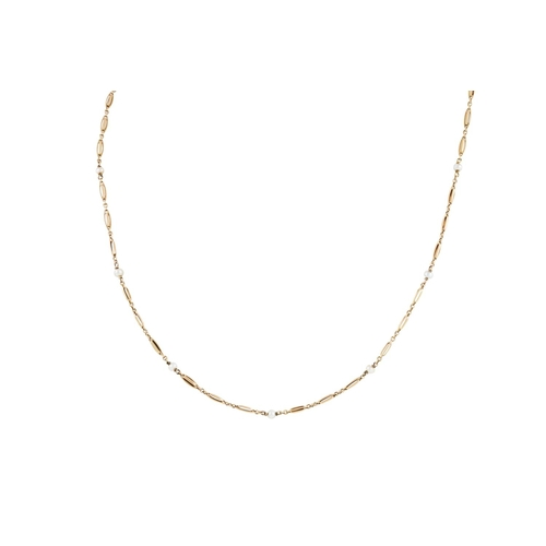 17 - A GOLD NECKLACE SET THROUGHOUT WITH SEED PEARLS, total weight 3.1 gms, length 14.5''/37cm...