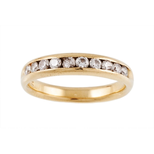 19 - A DIAMOND HALF ETERNITY RING, mounted in 18ct yellow gold, ring size M...