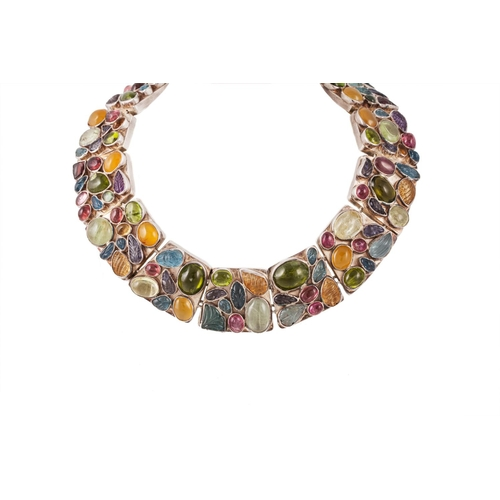 23 - A GEMSET NECKLACE, of collarette design, each panel set with various collet set gems...