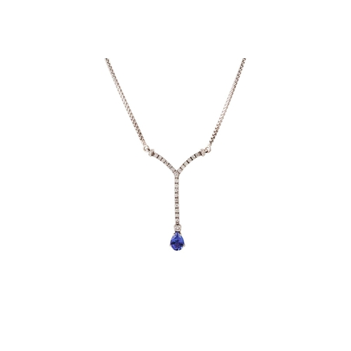 26 - A TANZANITE AND DIAMOND NECKLACE, the pear shaped tanzanite suspended from a diamond set bar, to an ...