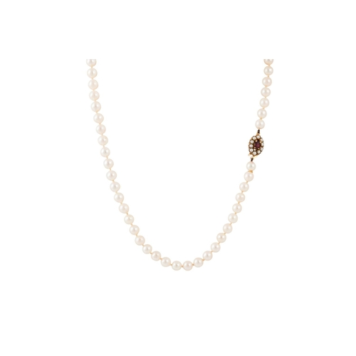 29 - A SINGLE ROWED CULTURED PEARL NECKLACE, to a garnet and pearl clasp...