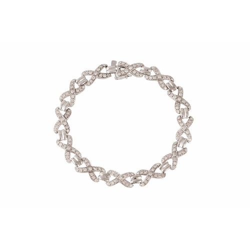 32 - A DIAMOND SET BRACELET, set with diamond x - shaped link, all mounted in 9ct white gold. Estimated; ...