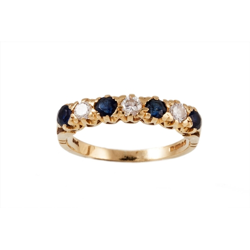 40 - A SEVEN STONE DIAMOND AND SAPPHIRE RING, mounted in yellow gold, size L...