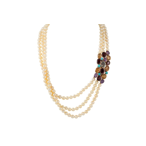 41 - A THREE ROWED CULTURED PEARL NECKLACE, to a multi gem set gold clasp...