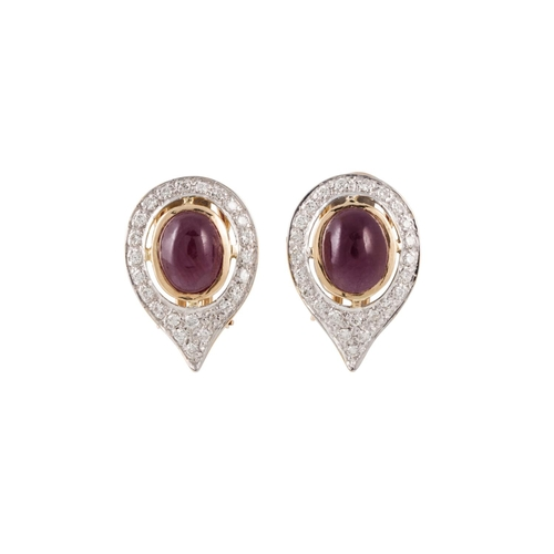 42 - A PAIR OF RUBY AND DIAMOND CLUSTER EARRINGS, the cabachon rubies to a diamond surround, mounted in g...