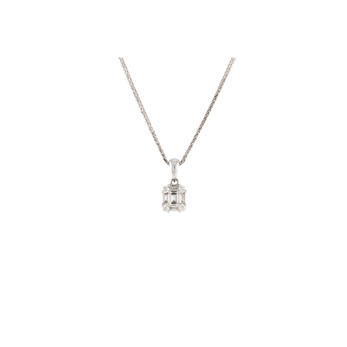 45 - A DIAMOND SET PENDANT, with baguette and brilliant cut diamonds of approx. 0.30 ct in total, on chai...
