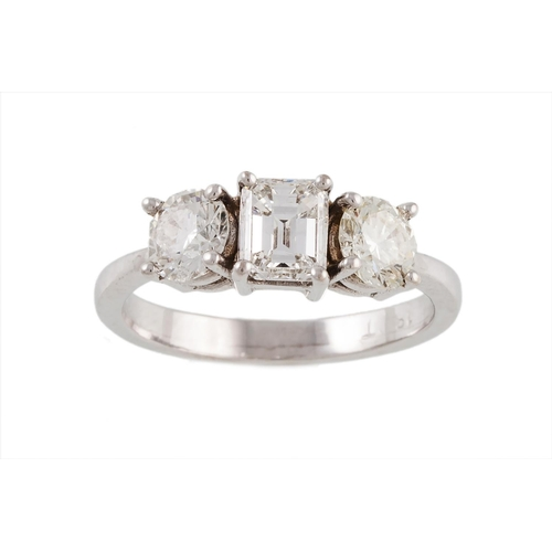 48 - A THREE STONE DIAMOND RING, with an emerald cut diamond of approx. 0.55 ct., G/H, two brilliant cut ...