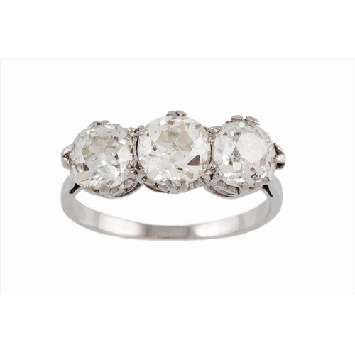 52 - A THREE STONE DIAMOND RING, with old cut diamonds, one diamond of  approx 1.03 ct and two diamonds o...