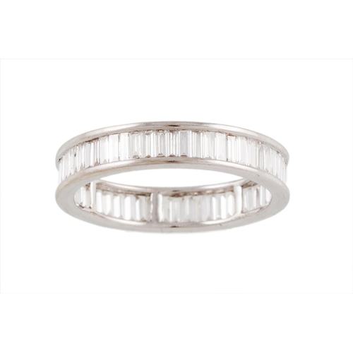 53 - A FULL BANDED DIAMOND ETERNITY RING, set with baguette cut diamonds, mounted in white gold, size N...