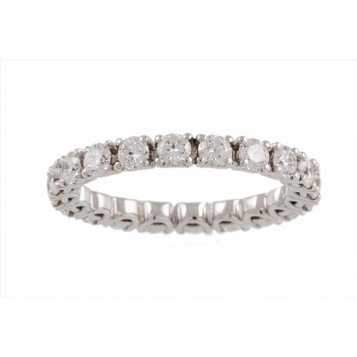 54 - A FULL BANDED DIAMOND ETERNITY, set with brilliant cut diamonds, mounted in white gold, size M/N. Es...