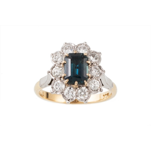 8 - A SAPPHIRE AND DIAMOND CLUSTER RING, the central sapphire surrounded by diamonds, mounted in 18ct ye...