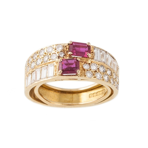 9 - A DIAMOND AND RUBY DRESS RING, mounted in 18ct yellow gold. Size M....