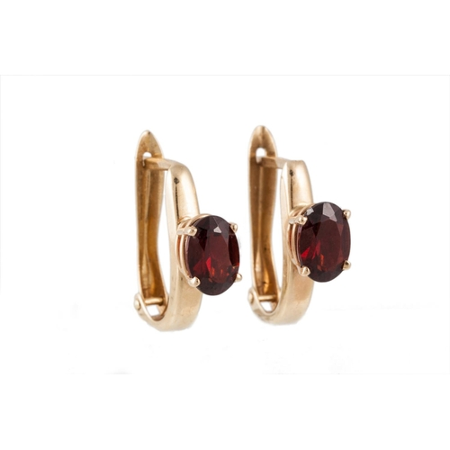 4 - A GARNET SOLITAIRE RING mounted in 10ct gold, size Q-P,  together with a pair of garnet earrings, mo...