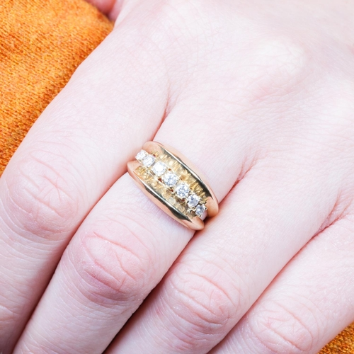 13 - A DIAMOND DRESS RING, the diamonds estimated to weigh 0.40 ct, Size N....