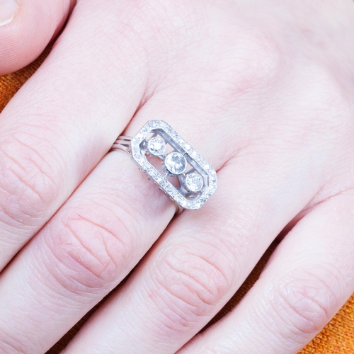 38 - A DIAMOND CLUSTER RING, set with three old cut diamonds, collet set to a diamond surround, mounted i...