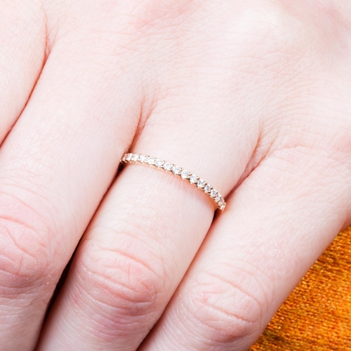 56 - A DIAMOND HALF ETERNITY RING, set with brilliant cut diamonds, mounted in yellow gold, size K½...