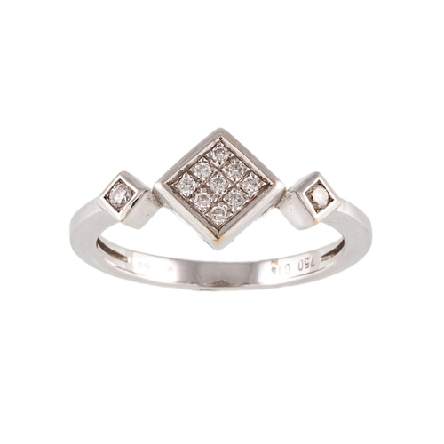 11 - A DIAMOND DRESS RING, mounted in 18ct white gold. Estimated weight of diamonds: 0.14 ct, size N½....