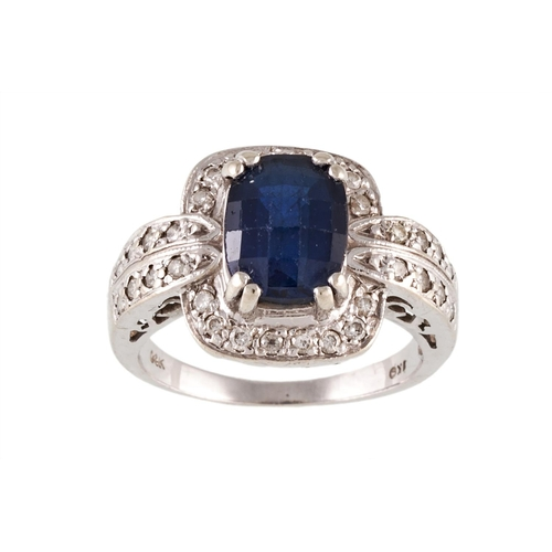 2 - A SAPPHIRE AND DIAMOND CLUSTER RING, the mixed cut sapphire with a diamond surround, mounted in 14ct...