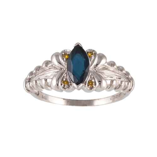 24 - A SAPPHIRE AND DIAMOND RING, the marquise cut sapphire to yellow diamond points, mounted in white go...