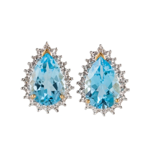 25 - A PAIR OF TOPAZ AND DIAMOND CLUSTER EARRINGS, the pear shaped topaz to brilliant cut diamond surroun...