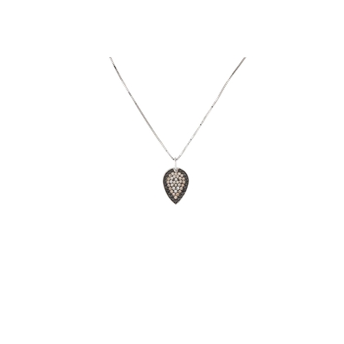 33 - A DIAMOND SET PENDANT, the tear drop shaped pendant set with white and black diamonds, mounted in wh...