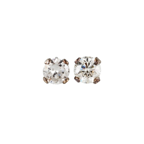 35 - A PAIR OF DIAMOND STUD EARRINGS, the brilliant cut diamonds mounted in white gold. Estimated; weight...