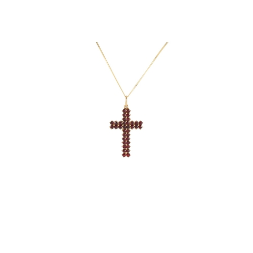 38 - A GARNET SET CROSS, mounted in 14ct gold, on a gold chain...