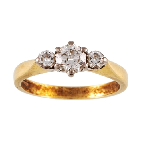 5 - A THREE STONE DIAMOND RING, mounted in 18ct yellow gold. Estimated total weight of diamonds: 0.75 ct...