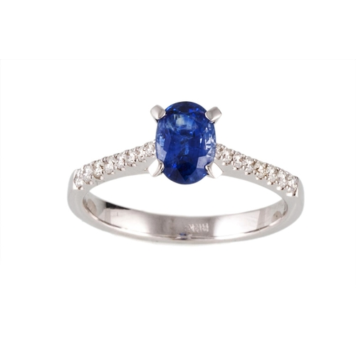 54 - A SAPPHIRE SINGLE STONE RING, the oval sapphire to diamond shoulders, mounted in 18ct white gold. Es...