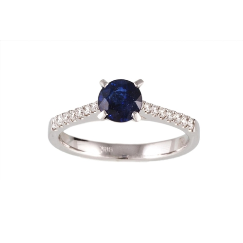 56 - A SAPPHIRE SINGLE STONE RING, the circular sapphire to diamond shoulders. Estimated; weight of sapph...