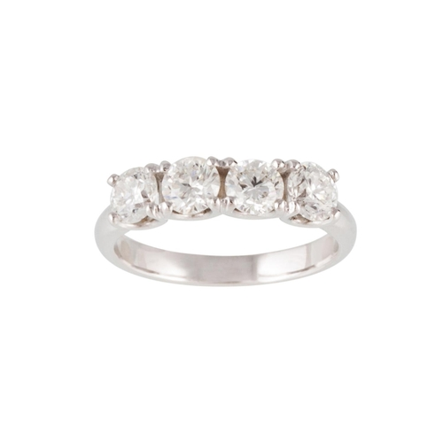 57 - A FOUR STONE DIAMOND RING, the brilliant cut diamonds mounted in 18ct white gold. Estimated; weight ...