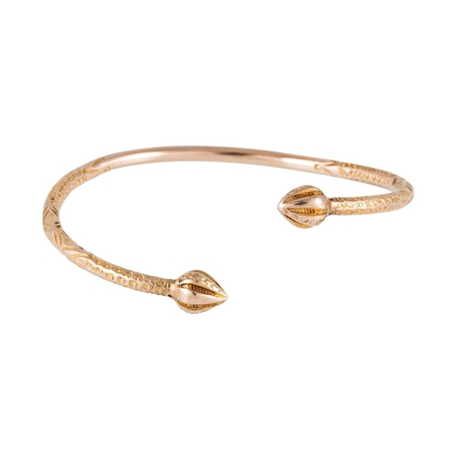 117 - 10CT GOLD SLAVE BANGLE, with engraved decoration, 23.6 grams...