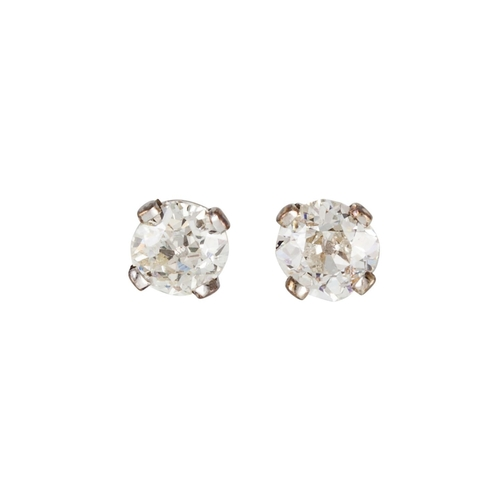 131 - A PAIR OF DIAMOND STUD EARRINGS, the old cut diamonds mounted in white gold. Estimated; weight of di...