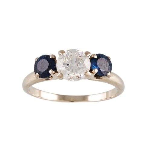 144 - A DIAMOND AND SAPPHIRE THREE STONE RING, the brilliant cut diamond to circular sapphires, mounted in...