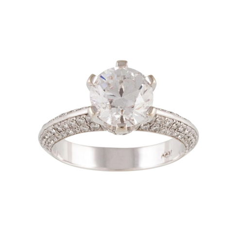 147 - A DIAMOND SOLITAIRE RING, set in bespoke pavé set 18ct white gold mount. Together with HRD cert stat...