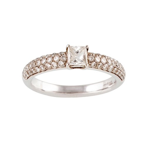 16 - A DIAMOND SOLITAIRE RING, the princess cut diamond with pavé shoulders. Estimated weight of diamond:...