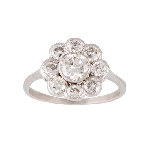 160 - A DIAMOND DAISY CLUSTER RING, Estimated; weight of diamonds 1.20ct, size L....