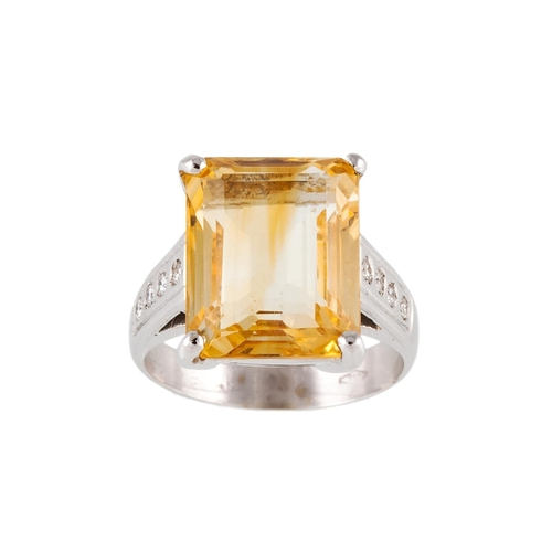 177 - A CITRINE DRESS RING, with diamond shoulders, mounted in 18ct white gold, size L....