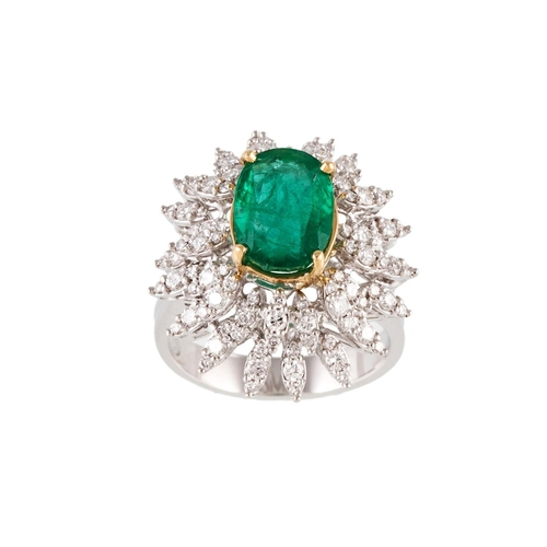 180 - AN EMERALD AND DIAMOND CLUSTER RING, the oval cut emerald to a surround of diamonds, mounted in 18ct...