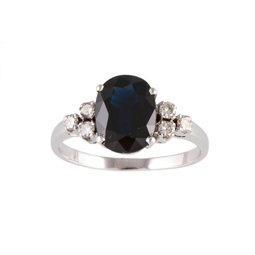 183 - A SAPPHIRE AND DIAMOND RING, the oval cut sapphire and diamonds mounted in 18ct white gold,. Estimat...