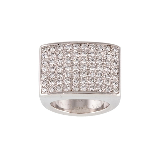 185 - A DIAMOND PAVÉ DRESS RING, by Piaget, mounted in 18ct white gold. Estimated; weight of diamonds 1.50...