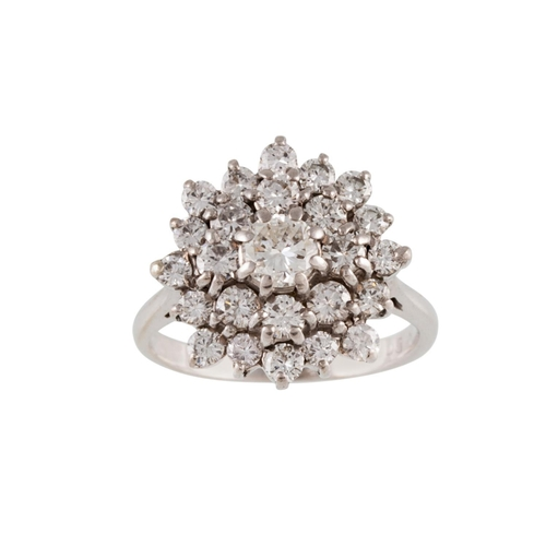 19 - A DIAMOND CLUSTER RING, mounted in gold. Estimated weight of diamonds: 1.30 ct, colour and clarity; ...