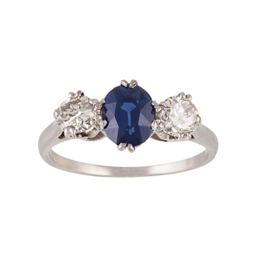 203 - A SAPPHIRE AND DIAMOND THREE STONE RING, one oval cut sapphire of approx 1.12ct and diamonds of appr...