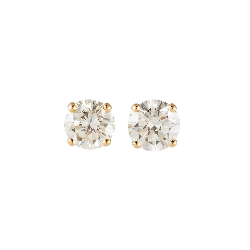 245 - A PAIR OF DIAMOND STUD EARRINGS, the brilliant cut diamonds mounted in yellow gold. Estimated; weigh...