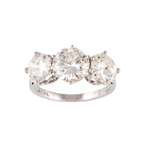 247 - A DIAMOND THREE STONE RING, the brilliant cut diamonds mounted in 18ct white gold. Estimated; weight...