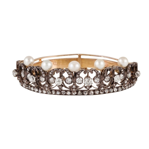 249 - AN ANTIQUE PEARL AND DIAMOND BANGLE,  of open worked design, set with old cut diamonds and pearls, m...