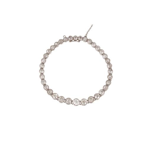 250 - AN EARLY 20TH CENTURY DIAMOND LINE BRACELET, the graduating collet set diamonds mounted in white gol...