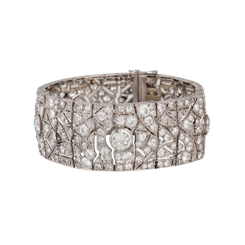 251 - AN ART DECO DIAMOND BRACELET, of geometric plaque design, set throughout with old cut diamonds, in f...