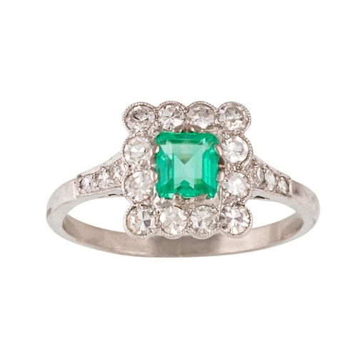 288 - AN EMERALD AND DIAMOND CLUSTER RING, one octagonal cut emerald of 0.45ct with gem report, and diamon...