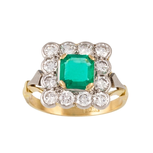 289 - AN EMERALD AND DIAMOND CLUSTER RING, one octagonal cut emerald of 0.77ct with gem report, and diamon...